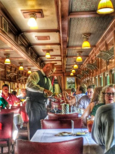 Eureka Springs & North Arkansas Railway inside train car people having lunch