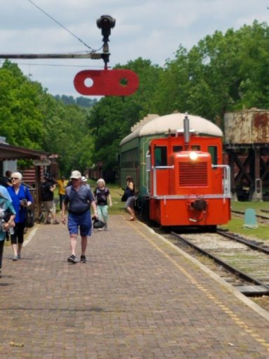 Eureka Springs & North Arkansas Railway locomotive and people walking
