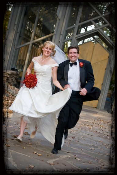 Eureka Springs bride and groom running