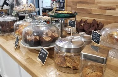 Coffee House table with many desserts displayed